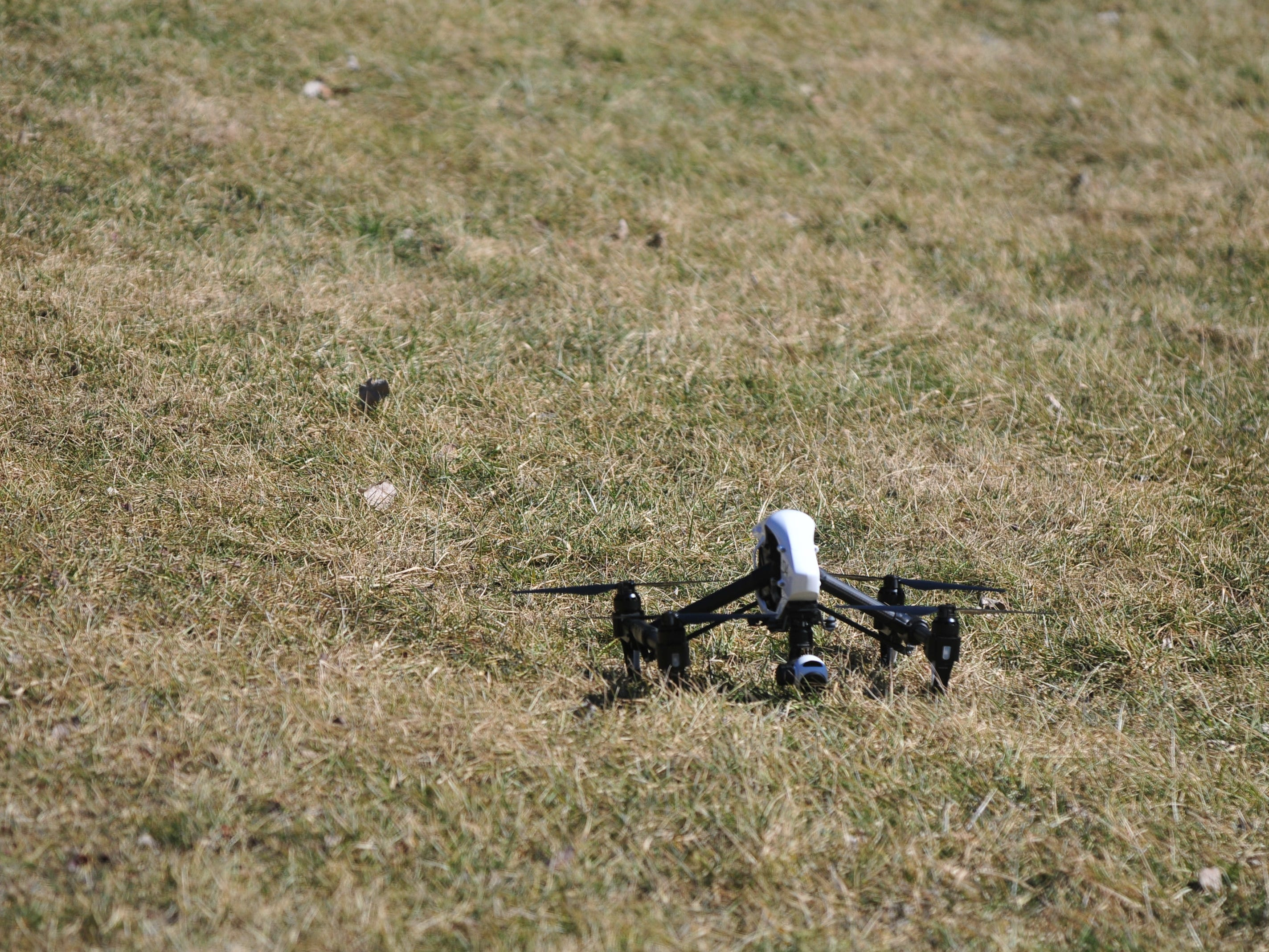 A drone sits in the grass at the Test Road trail head Monday afternoon during the search for Jake Huntington.