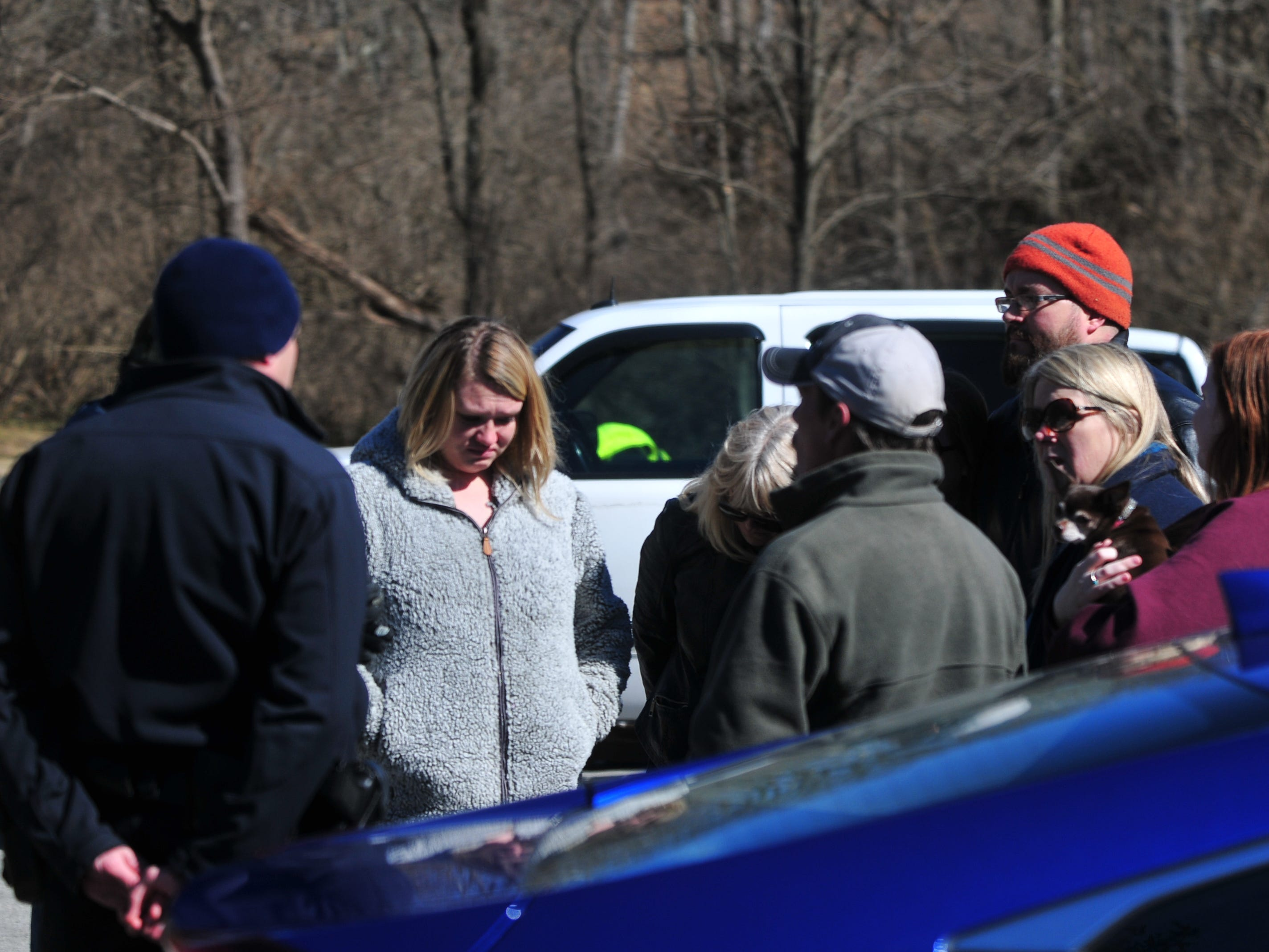Lt. James Doll of the Richmond Police Department updates family members at the Test Road trail head Monday afternoon during the search for Jake Huntington.