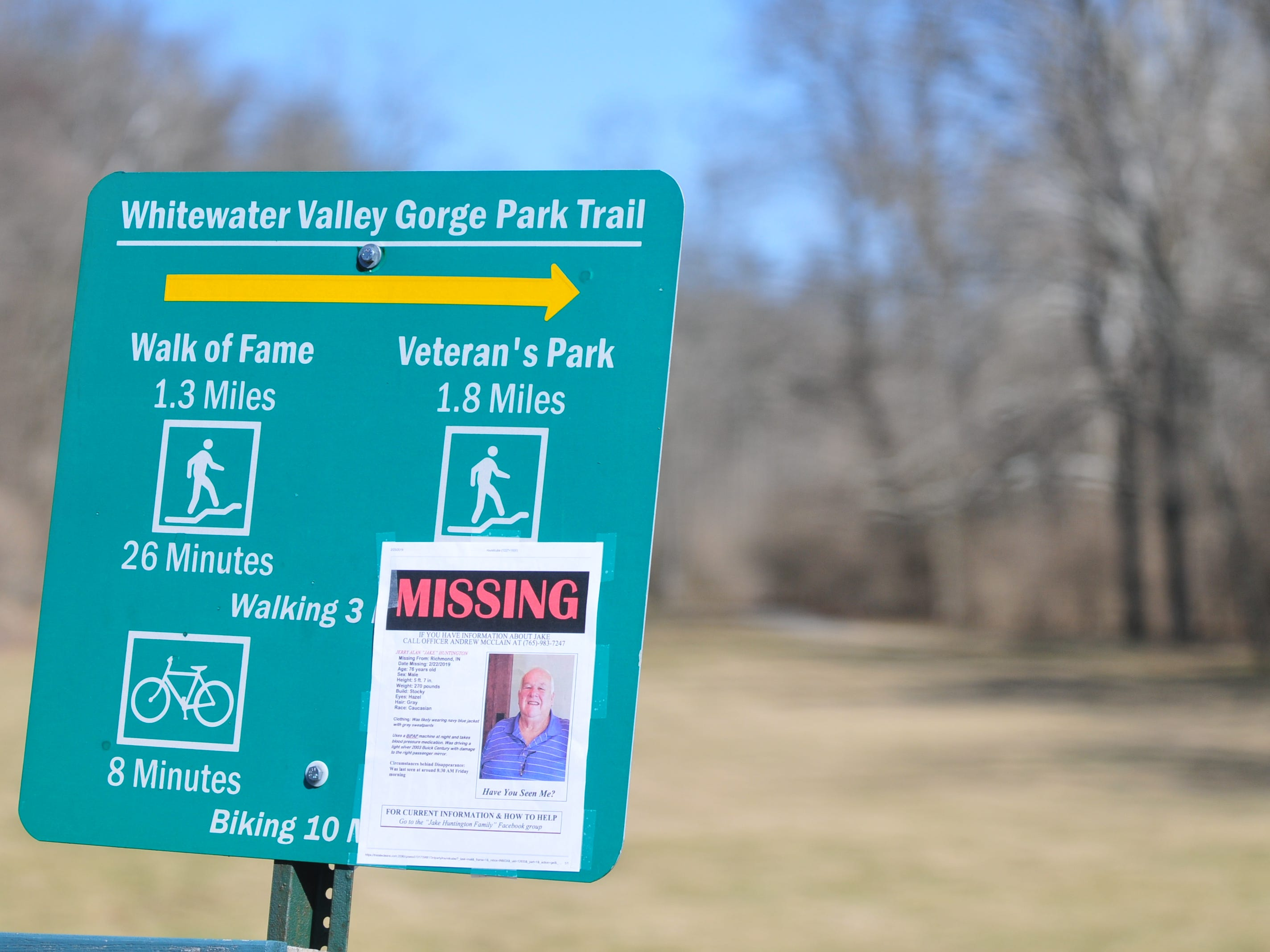 A sign was flier was posted at the Test Road trail head Monday afternoon during the search for Jake Huntington.