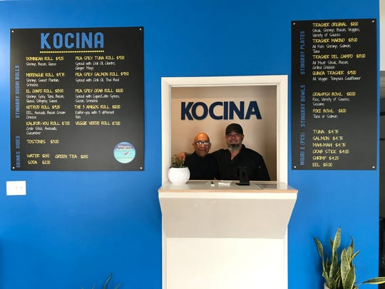 """The father-son team of Radhames """"Rod"""" and Jose Veras pose at their new take-out restaurant, Kocina."""