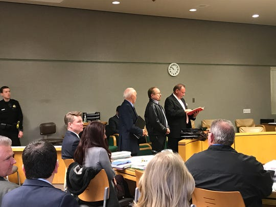 Dr. Larry Richard Pyle, center, stands with his attorney John Kucera, far right, in court on Monday, Feb. 25, 2019.