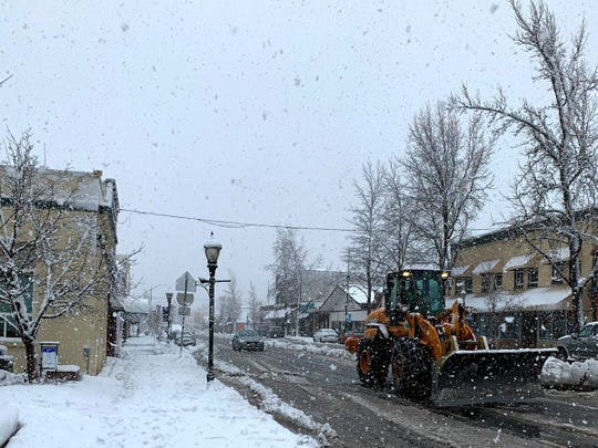 Snow falls in Mount Shasta on Monday, where as much as 12 inches of snow was expected in the city and as much as 20 inches above 3,000 feet.