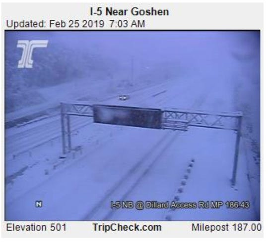 Interstate 5 is blanketed with snow south of Eugene, leading to a closure near Cottage Grove.