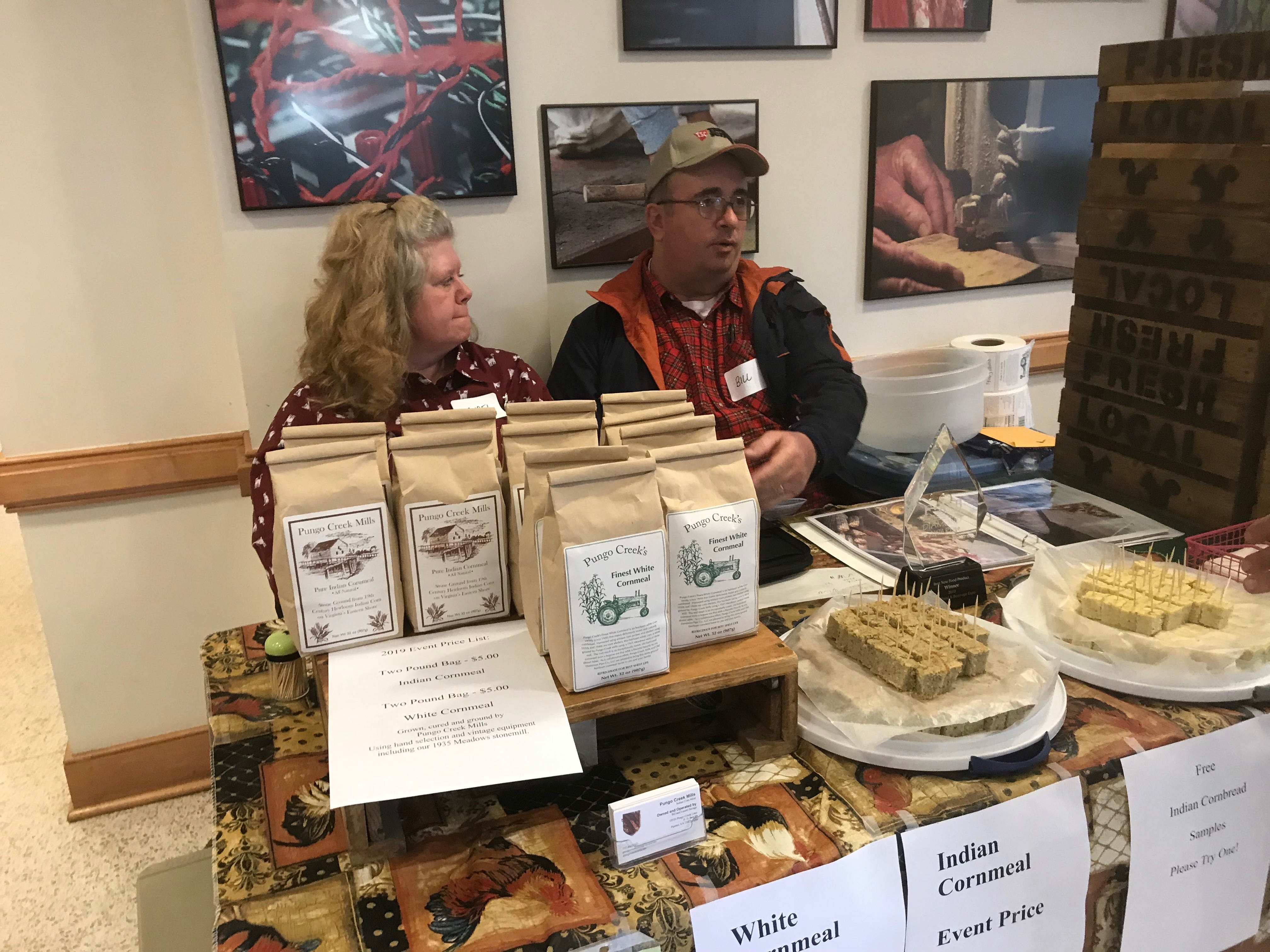 The Savages, owners of Pungo Creek Mill offer samples of cornbread made from heritage varieties of corn grown on their farm in Accomack County, Virginia, at Eastern Shore Community College's Heritage Festival on Saturday, Feb. 23, 2019.