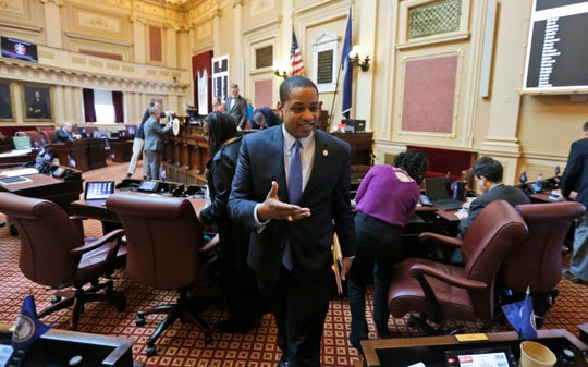 Virginia Lt. Gov. Justin Fairfax exits the floor after the Senate adjourned its 2019 session at the Capitol in Richmond on  Sunday, Feb. 24, 2019.