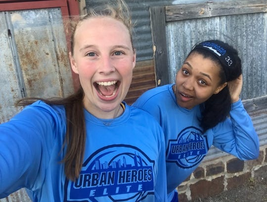 Benton's Emily Ward and Loyola's Chelsea Johnson share a laugh on an AAU road trip.