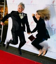 Artists Robert Trudeau and Talbot Hopkins take a leap for a paparazzi photo on the Red Carpet at The Robbys.