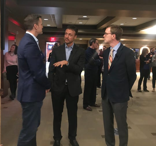Poet CEO Jeff Broin (center) discusses the biorefining process with Sioux Falls Mayor Paul TenHaken (left) and Congressman Dusty Johnson before a contract signing ceremony between Poet and the city of Sioux Falls.