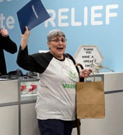 On Wednesday, Jan. 16, 2019, an Ohio woman celebrates being one of the first patient sales of that state's medical marijuana program at Cresco Labs CY+, a dispensary in Wintersville, Ohio. In late Feb. 2019, Missouri officials released draft rules pertaining to patient ID cards, as the Show-Me State sets up a medical marijuana system this year.