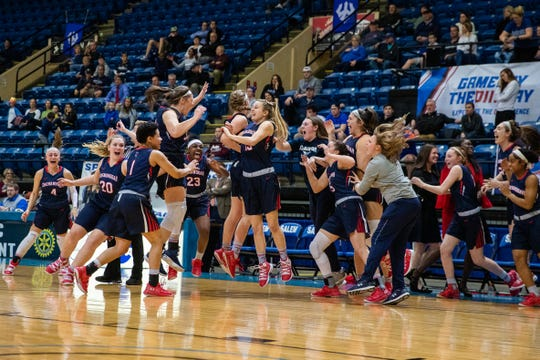 Shenandoah players celebrate winning the 2019 ODAC Women's Basketball Championship Sunday at the Salem Civic Center.