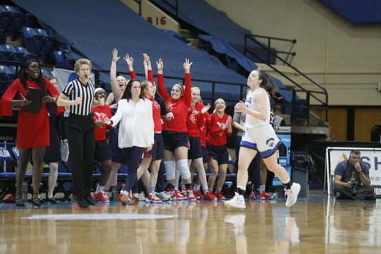 Shenandoah players cheer Jordan Sondrol's 3-point basket in the third quarter of Sunday's ODAC Tournament championship game. Sondrol hit back-to-back 3s in the quarter to extend Shenandoah's lead to 12 over Washington & Lee. Sondrol's younger sister, Sarah (white knee paddings) was among those cheering.