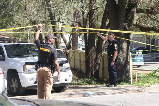 Tallahassee Police investigators canvass the scene where a 17-year-old was gunned down in the parking lot of an Old Bainbridge Road daycare Monday.