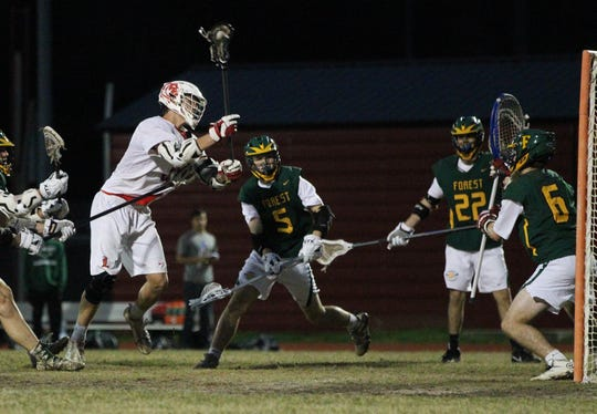 Leon's Cameron Curry scores a goal as the Lions' lacrosse team played Ocala Forest in its season opener on Feb. 18, 2019.
