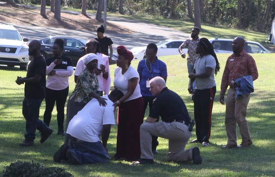 Family and friends of a 17-year-old killed in an Old Bainbridge Road daycare's parking lot mourn in the yard of a neighboring church.