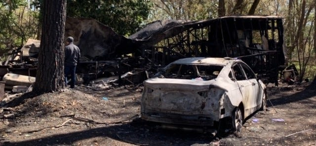 The remains of a car and mobile home where a 74-year-old man was pronounced dead following an overnight house fire in Quincy, according to Gadsden County Sheriff's Office.