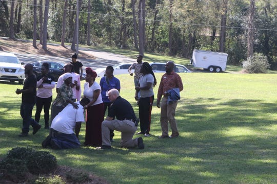 Family and friends of a 17-year-old teen killed in a shooting Monday on Old Bainbridge Road mourn in the yard of a neighboring church.