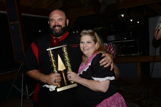 Matt Piscitelli accepts his one-of-a-kind pie eating trophy from Staci Dunn at Hoedown for HANDS of St. Lucie County at  Summer Crush Winery.