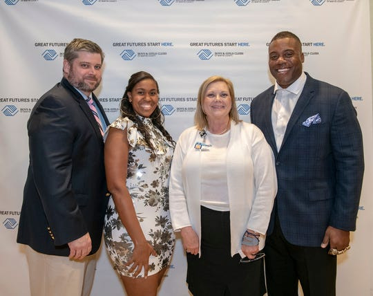 """Keith """"Fletch"""" Fletcher, CEO/president of the Boys & Girls Clubs of Martin County; Monique Waters, event chair; Laurie Gaylord, Martin County superintendent of schools, and Roland Williams, former NFL superstar, at the Great Futures Dinner of the Boys & Girls Clubs of Martin County."""