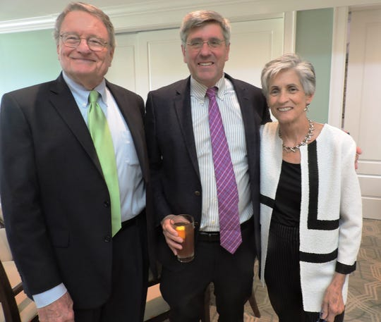 Mike Stetson, left, keynote speaker Steve Moore and Kate Boland, chair of Center for Constitutional Values, at the Feb.22 luncheon at Piper's Landing Yacht and Country Club.