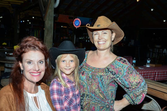 Jessica Kunkel, left, with Vivi and Nyla Pipes at Hoedown for HANDS of St. Lucie County at  Summer Crush Winery.