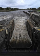 Water from the C-44 canal flows through two of the locks at the St. Lucie Lock and Dam, each gate opened at almost two feet on Feb. 25, 2019.