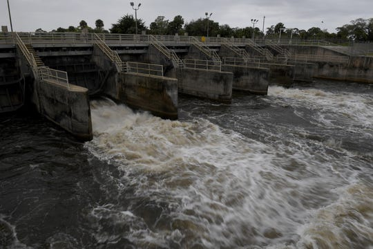 Water from the C-44 canal flows through two of the locks at the St. Lucie Lock and Dam, each gate opened at almost two feet on Monday, Feb. 25, 2019, after the Army Corps of Engineers announced last Friday that they would increase the discharges from Lake Okeechobee due to the recent rise in water levels, and reduce the probability of high-volume releases in the upcoming wet season.