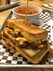 The Country Boy has mac and cheese, plus melted cheddar, gruyere, and shredded BBQ pork, stuffed between two slices of bread.