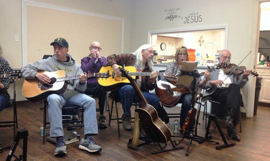 Members of the Old Time Country Bluegrass Gospel Music Association perform a jam session Sunday after the group's monthly potluck dinner at Ventura Church of Christ.