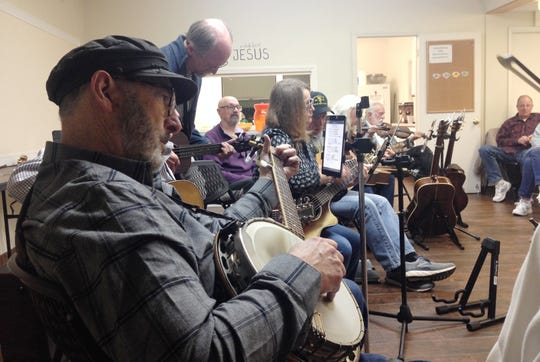 Wayne Agnew, co-founder of the Old Time Country Bluegrass Gospel Music Association, performs during a jam session.
