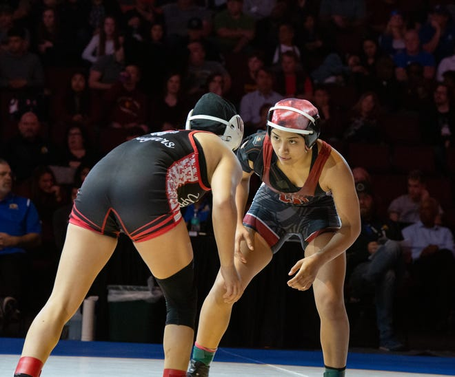 Mt. Whitney's Ashley Venegas (right) competes against Adriana Lopez, of Upper Lake, on Saturday in the 121-pound championship match in Bakersfield.