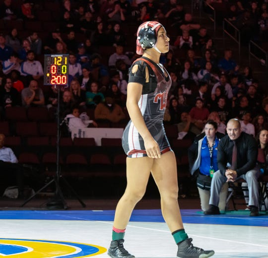 Mt. Whitney's Ashley Venegas gets ready for the 121-pound title match on Saturday at the CIF State Wrestling Championships in Bakersfield.