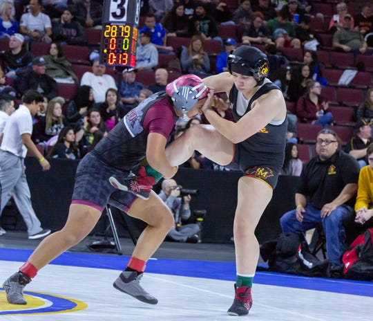 Mt. Whitney's Anahi Moreno, left, placed sixth in the 137-pound weight class on Saturday at the CIF State Wrestling Championships in Bakersfield.