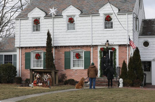 """A home along Grandview Boulevard in Yonkers is decorated for the Christmas holiday, as a production crew with the television series """"Mr. Robot"""" films a scene, Feb. 25, 2019."""