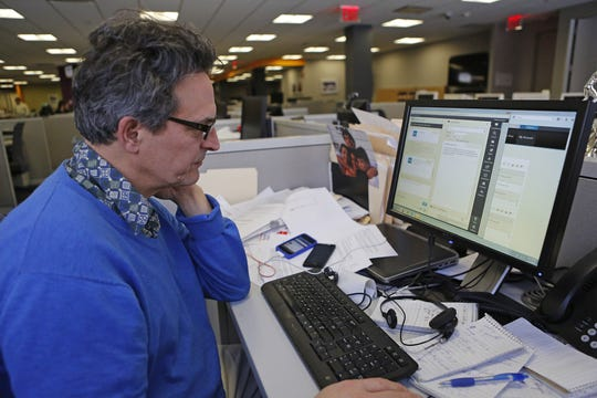 Tax Watch columnist David McKay Wilson helps a caller via chat during a tax hotline session at The Journal News office in this file photo.