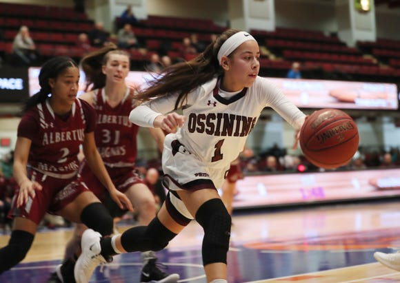 Ossining's Jaida Strippoli (1) controls a rebound against Alberts Magnus during girls basketball playoff action at the Westchester County Center in White Plains  Feb. 25,  2019. Ossining won the game.
