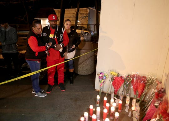 Shawn DeLoatch and his mother Gloria, as left, stand before a memorial of candles and flowers outside the Garnerville 7-Eleven Feb. 24, 2019. DeLoatch's wife, Melissa Castillo DeLoatch, died outside the 7-Eleven last week when she flung her body between her family and an oncoming car driven by Jason Mendez. Several dozen family members, supporters, and members of the Haverstraw Ambulance Corps came to the 7-Eleven Sunday night for a vigil in memory of Melissa Castillo Deloatch. The family said they also wanted to honor the community for the support shown to them since the incident.