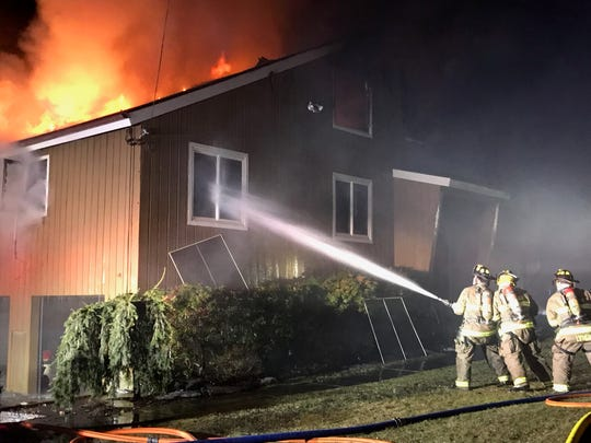Firefighters battle a blaze that damaged a house in Goldens Bridge on Feb. 24, 2019.