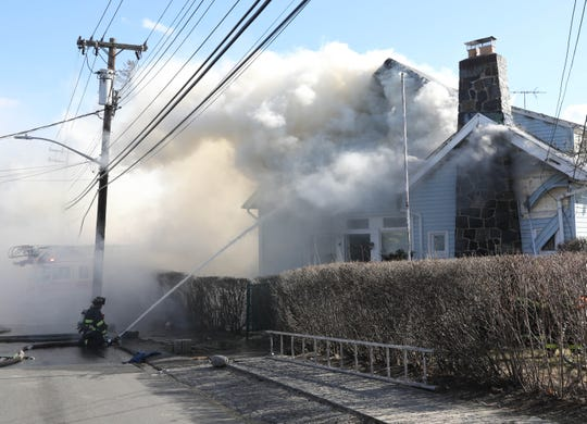 Mount Vernon Firefighters battle a fire at 5 Johnson Street in the city, Feb. 25, 2019.