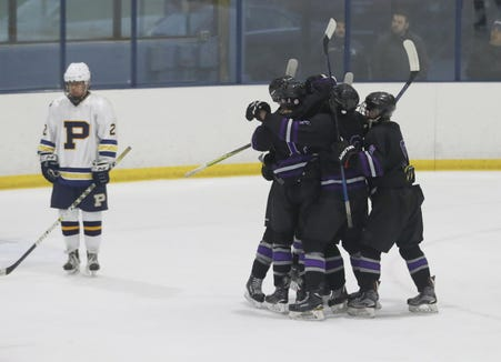 John Jay Cross River celebrates their first goal against Pelham during the Section 1 Division II championship hockey game at Sport-o-Rama in Monsey Feb. 24, 2019. John Jay defeated Pelham 5-1. John Jay defeated Pelham 5-1.