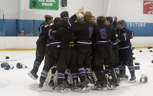 John Jay celebrated a Section 1 championship for the second year in a row, opting for the group hug instead of the dogpile on Sunday, Feb. 24, 2019 at Sport-O-Rama.