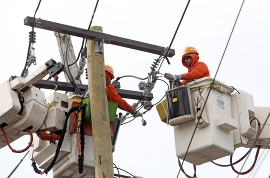 Orange and Rockland workers restore power on Piermont Avenue in Nyack after strong winds down trees and power lines Feb. 25, 2019.