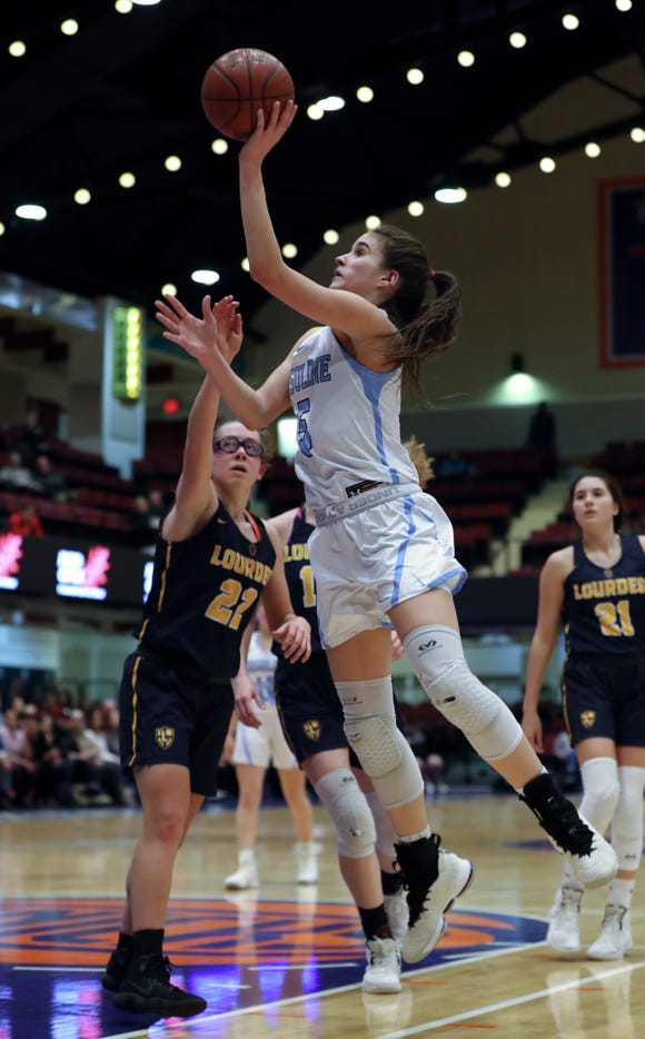 Ursuline's Sonia Citron shoots over Lourdes' Sofia Feigelson during their Section 1 class AA basketball semifinal at the Westchester County Center Feb. 25, 2019. Ursuline won 61-58.