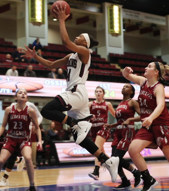 Ossining's Aubrey Griffin (44) drives to the basket against Alberts Magnus during girls basketball playoff action at the Westchester County Center in White Plains  Feb. 25,  2019. Ossining won the game.