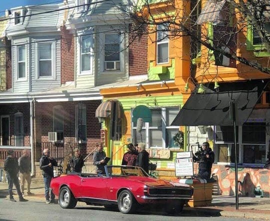 """Food Network star Guy Fieri, his famous Camaro convertible and a film crew were spotted Monday outside of the Wilmington restaurant Luigi Vitrone's Pastabilities. He might be filming an episode of """"Diners, Drive-ins and Dives."""""""