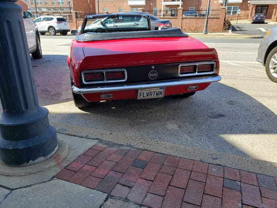 """Food Network star Guy Fieri's Camaro convertible with the license plate """"Flvrtown"""" was parked outside of Mrs. Robino's restaurant on Monday afternoon."""