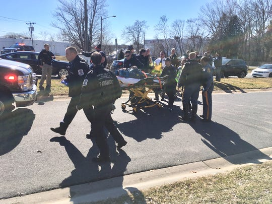 A Delaware State Police trooper is given treatment after being dragged by a SUV Monday afternoon.