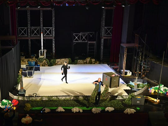 Andrea Knipp and Nate James of Ice Creative Entertainment set up the stage at the Wichita Theatre for the one-night-only production of Peter Pan and Friends on Ice.