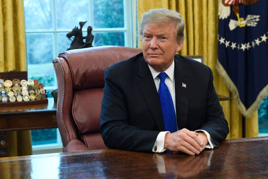 """FILE - In this Friday, Feb. 22, 2019, file photo, President Donald Trump listens during his meeting with Chinese Vice Premier Liu He in the Oval Office of the White House in Washington. Trump said Sunday he will extend a deadline to escalate tariffs on Chinese imports, citing """"substantial progress"""" in weekend talks between the two countries."""