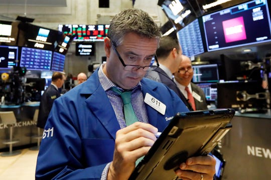 Trader Daniel Trimble works on the floor of the New York Stock Exchange. The U.S. stock market opens at 9:30 a.m. EST on Monday, Feb. 25.