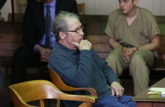 David Fisher waits for court to adjourn after a break during his sentencing hearing in Muskingum County Common Pleas Court on Monday.